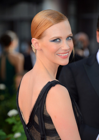 Actress January Jones, smiling, with smoky eye make-up