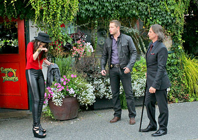 a still from Once Upon a Time featuring Ruby, David, and Mr. Gold