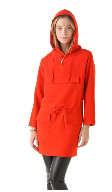 a model showing off the Raoul Utility Dress in clementine